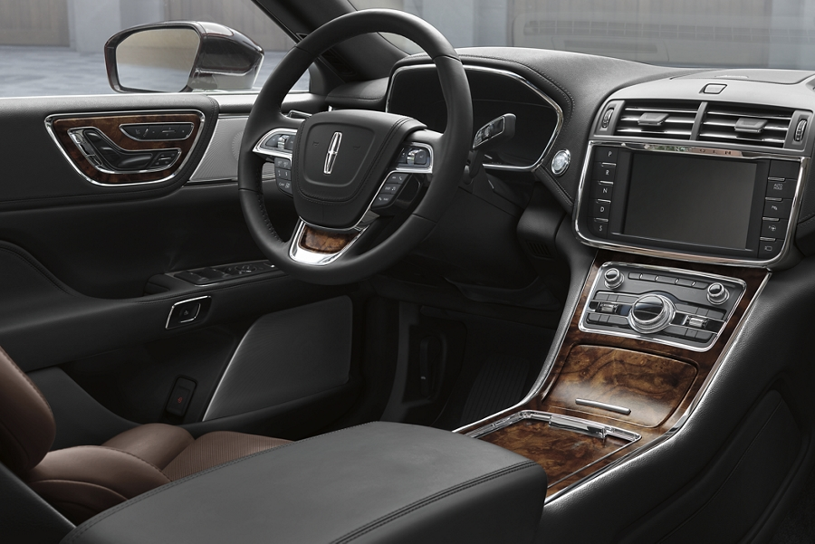 Captivating Brown Swirl Walnut wood details are shown throughout the cabin of a 2020 Lincoln Continental