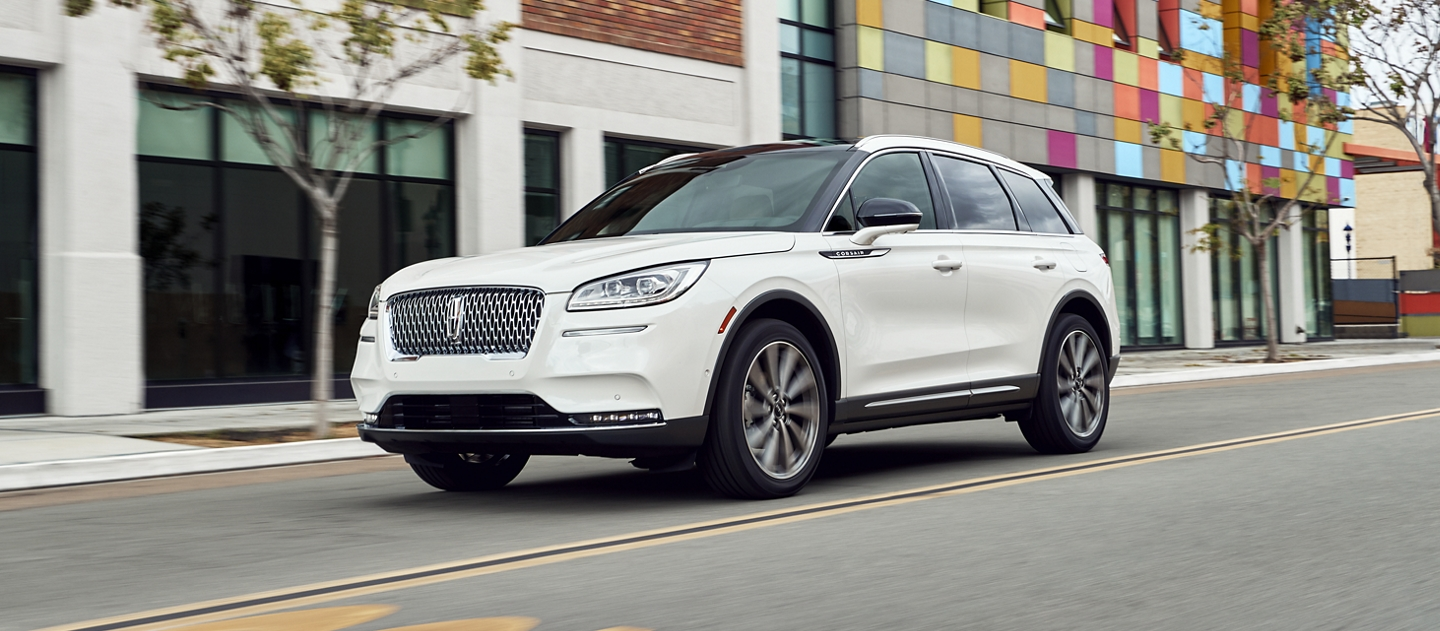 A 2020 Lincoln Corsair in pristine white is being driven with the smooth movement of the Suspension
