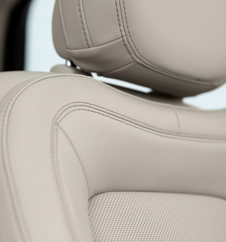 A detail shot of a leather trimmed Perfect Position front seat shows off artistic details like luxe materials precision stitching and supple curve