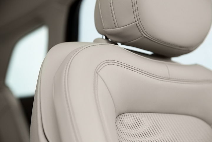 A detail shot of a leather trimmed Perfect Position front seat shows off artistic details like luxe materials precision stitching and supple curves