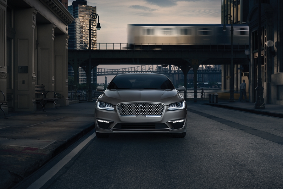 The daytime running lights and fog lamps of a 2020 Lincoln M K Z illuminate