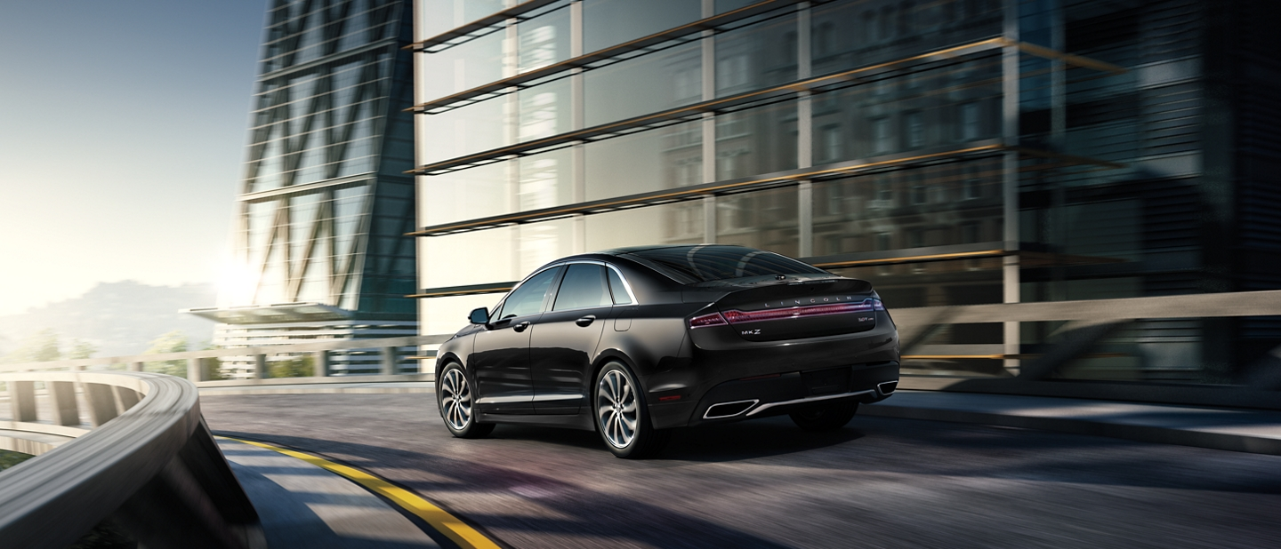The 2020 Lincoln M K Z shown in Infinite Black Metallic is elegantly navigated through a tight turn