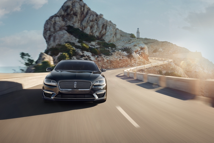 A 2020 Lincoln M K Z is shown being driven on a winding mountain road