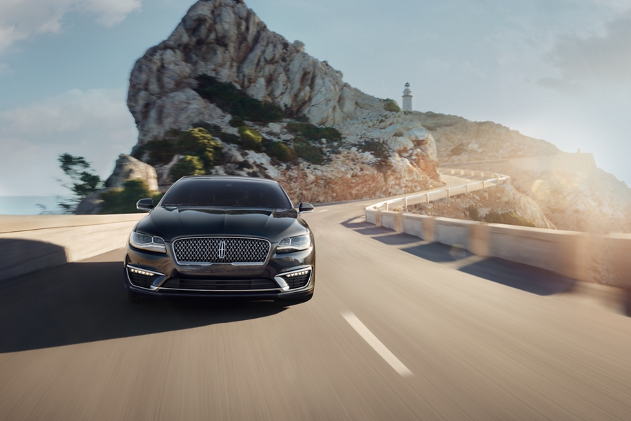A 2020 Lincoln M K Z is shown being driven along the winding mountain roads of Mallorca Spain