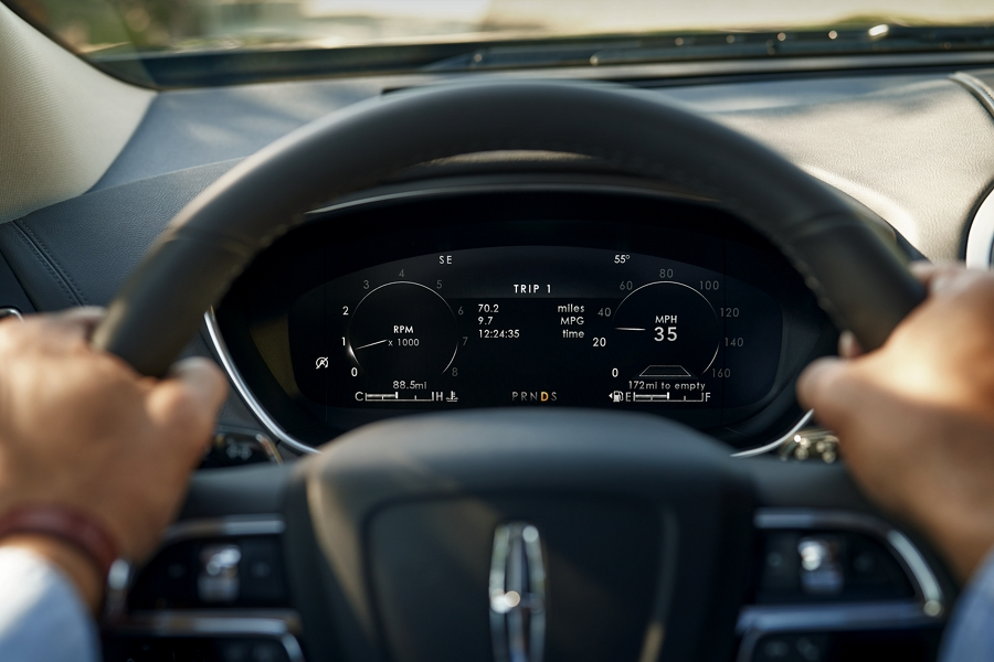 The twelve point three inch L C D instrument cluster is shown in the dashboard behind the steering wheel