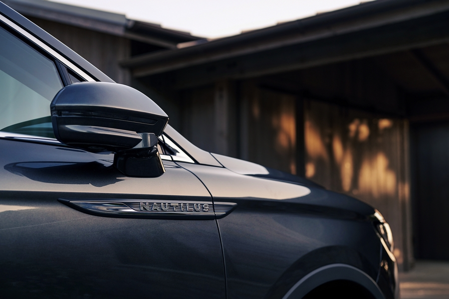 A close up shot of a 2020 Lincoln Nautilus shows the passengers side view mirror folded in