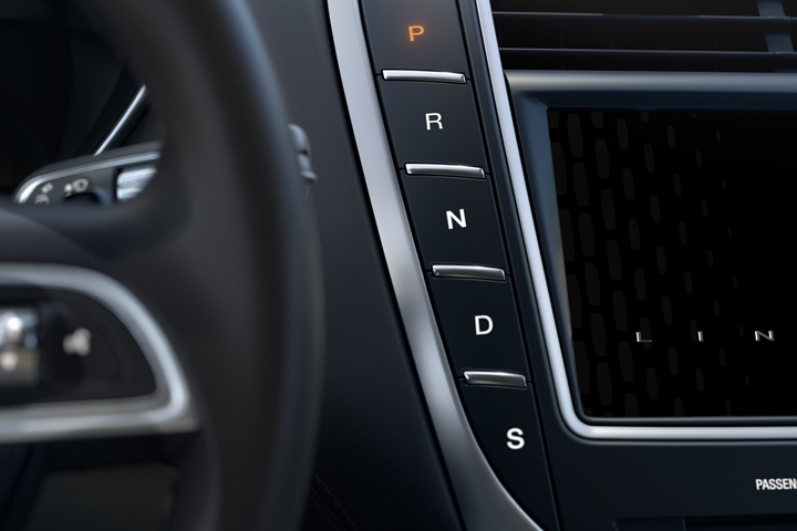 A close up image of the push button shifter located near the steering wheel of the 2020 Lincoln Nautilus