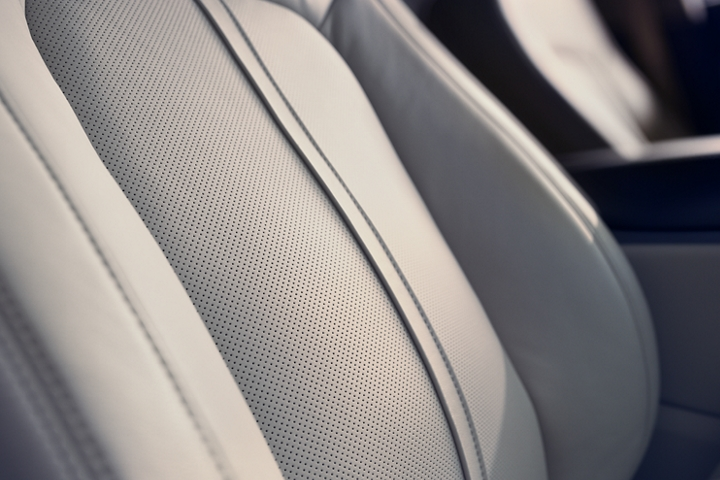 A close up image shows the rich details of the available leather trimmed front seats in a 2020 Lincoln Nautilus
