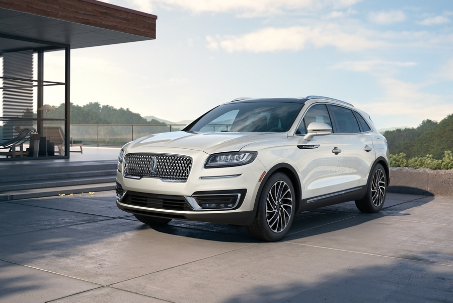A 2020 Lincoln Nautilus in the Ceramic Pearl exterior colour is seen parked near a modern home