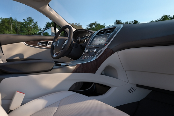 The centre stack of the 2020 Lincoln Nautilus is shown which features a pass through for convenient storage