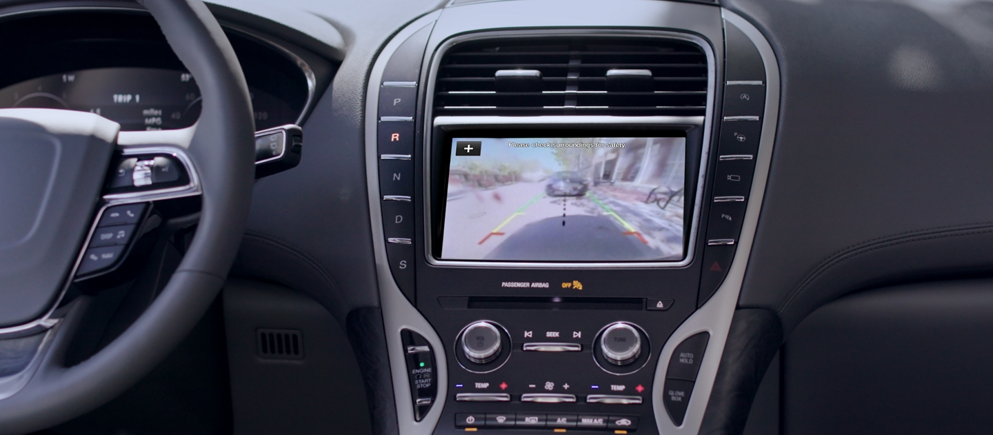 Courtesy of the rear camera the centre console screen of a 2020 Lincoln Nautilus displays what is behind the vehicle