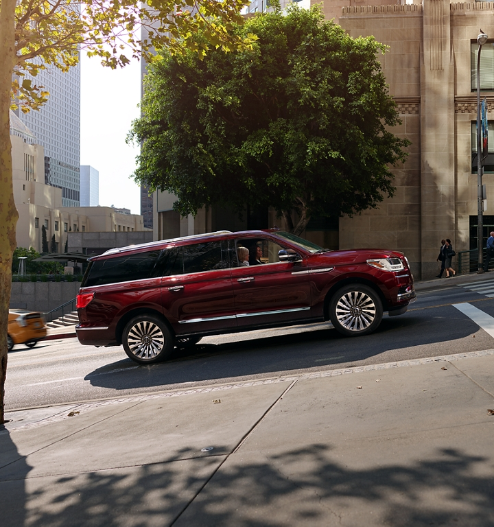 To demonstrate the Auto Hold feature the Lincoln Navigator is shown at a stop on a hill within a city setting