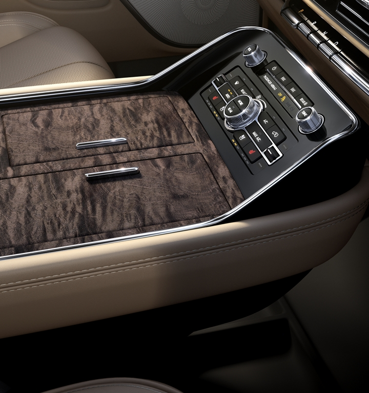 3 chambered centre front console with storage and access to mobile device charging