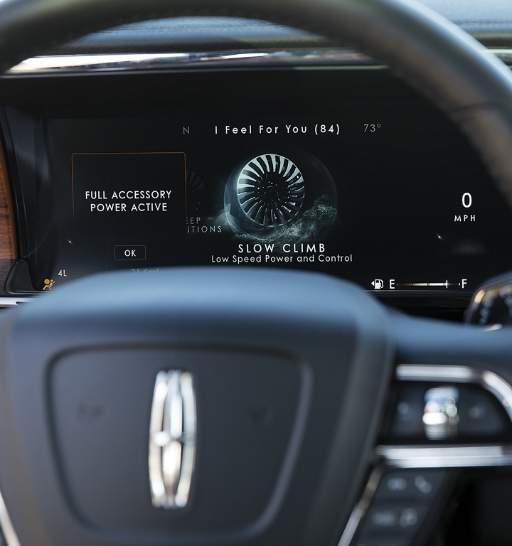 The slow climb setting of the six selectable Lincoln Drive modes is shown in the information cluster behind the steering wheel