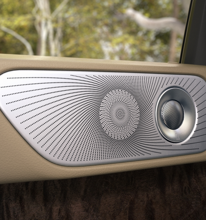 A speaker and tweeter are shown in the second row door of a Lincoln Navigator