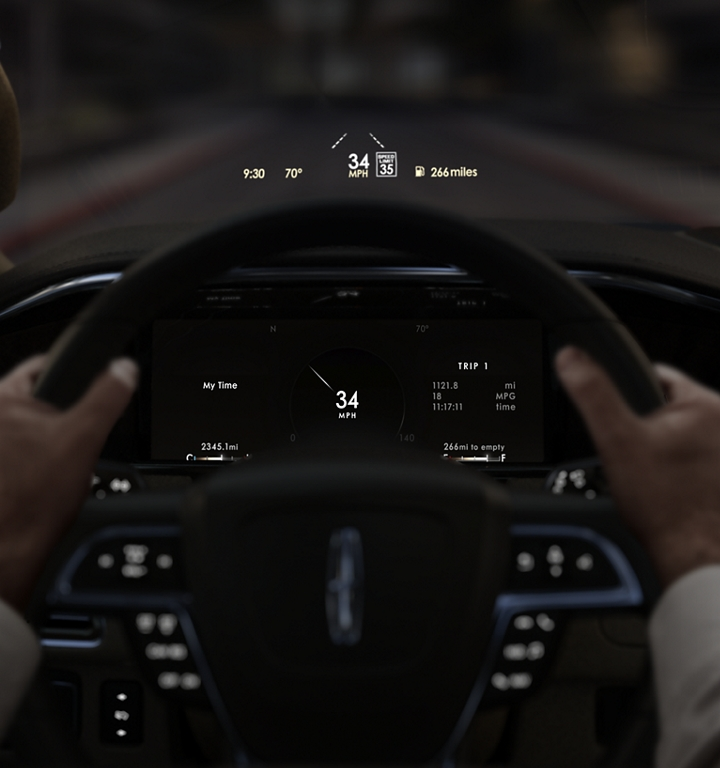 Information is shown being projected on the inside of the windshield via the available head up display