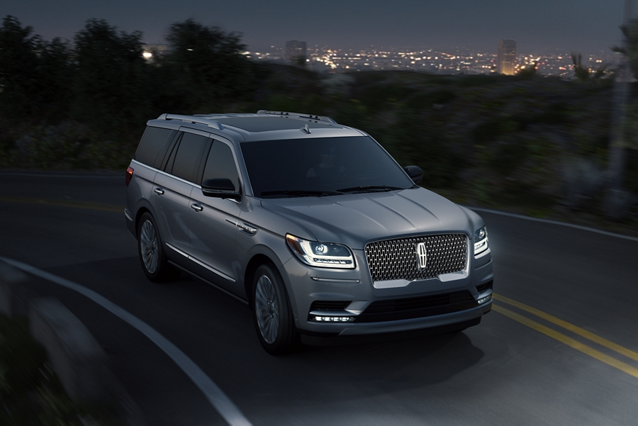 Bright L E D Adaptive headlamps are shown illuminated as a Lincoln Navigator is driven at night