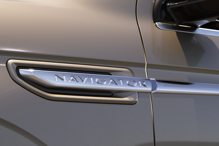 A close up of the chrome on a 2020 Lincoln Navigator badge above the front wheel well draws the eyes along the movement of horizontal design lines