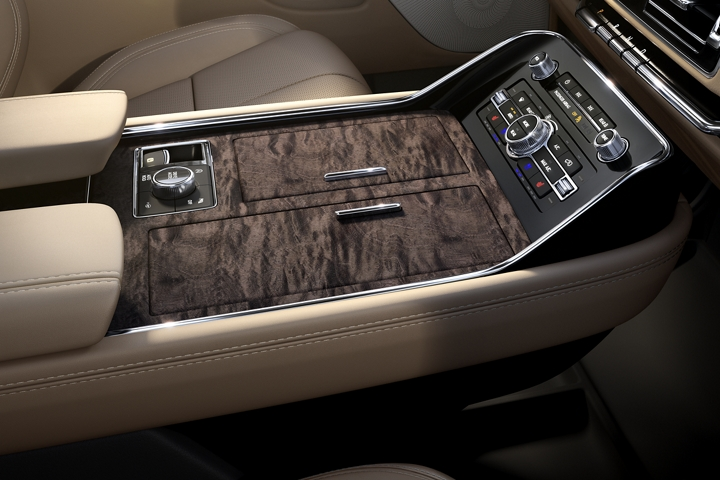 Deep polished wood featuring natural calico grain patterns adorns the spacious three chambered centre front console design