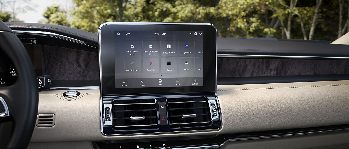 The sleek digital centre screen of a 2020 Lincoln Navigator displays different applications and hotspot plus signs that lead to more detailed content