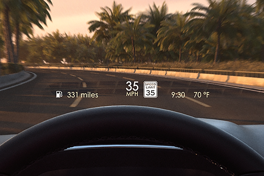 The bright Head Up Display projection puts vital information in focus on the windshield above the steering wheel as a driver navigates a city street