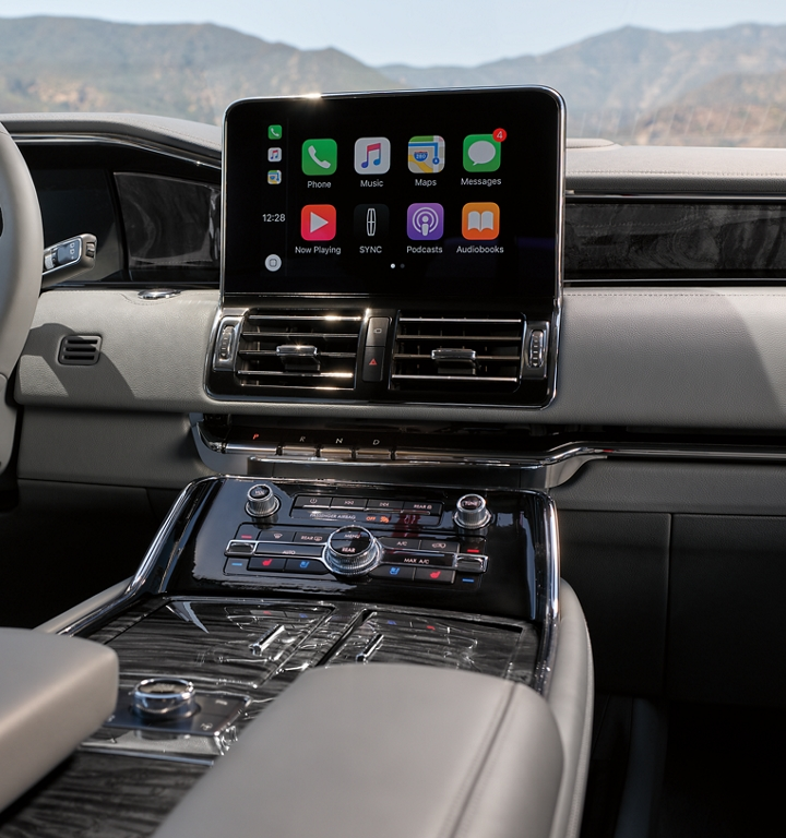 The broad digital centre screen inside a 2020 Lincoln Navigator shows a variety of popular applications that put technology at your fingertips