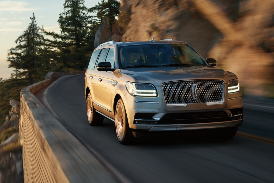A 2020 Lincoln Navigator being driven on a mountain road