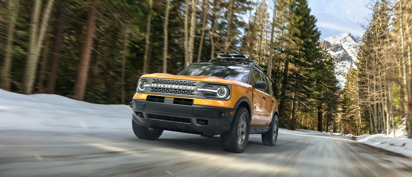 A 2021 Ford Bronco Sport being driven on a wooded road