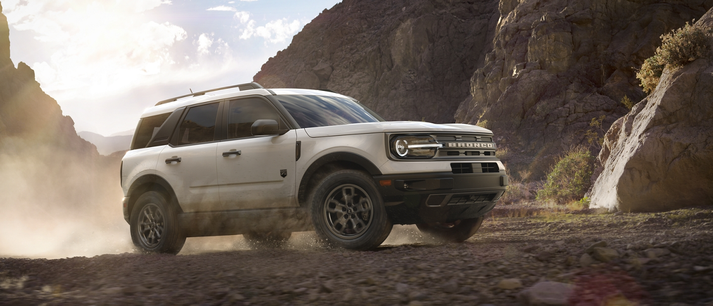 A 2021 Ford Bronco Sport being driven off road on a dirt covered terrain