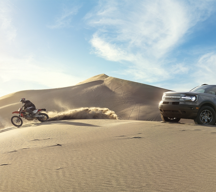 A 2021 Ford Bronco Sport parked at the top of a sand dune