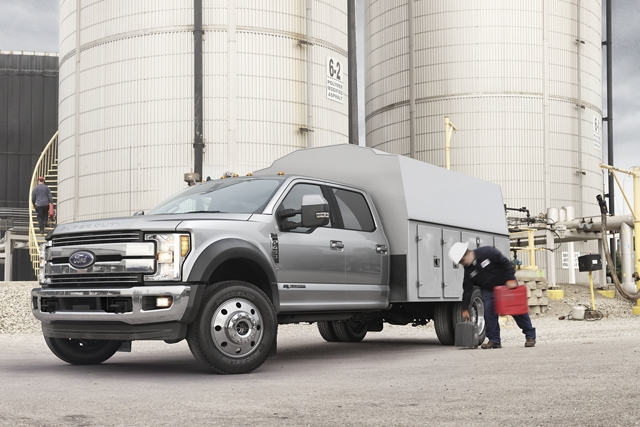 2020 Ford Super Duty Chassis Cab with utility box at worksite near silos
