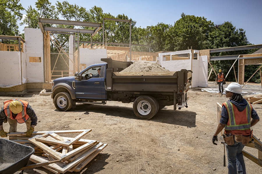2020 Ford Super Duty Chassis Cab parked at worksite with upfit carrying dirt