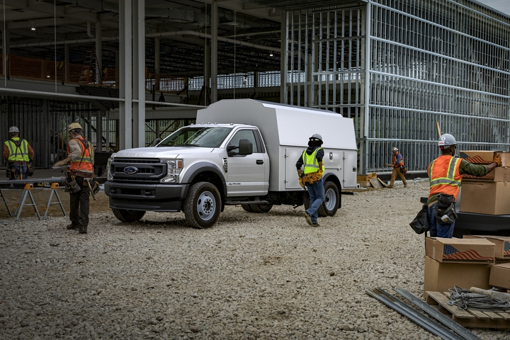 Workers near 2020 Ford Super Duty Chassis Cab F 5 50 X L in Oxford White with upfit at construction site