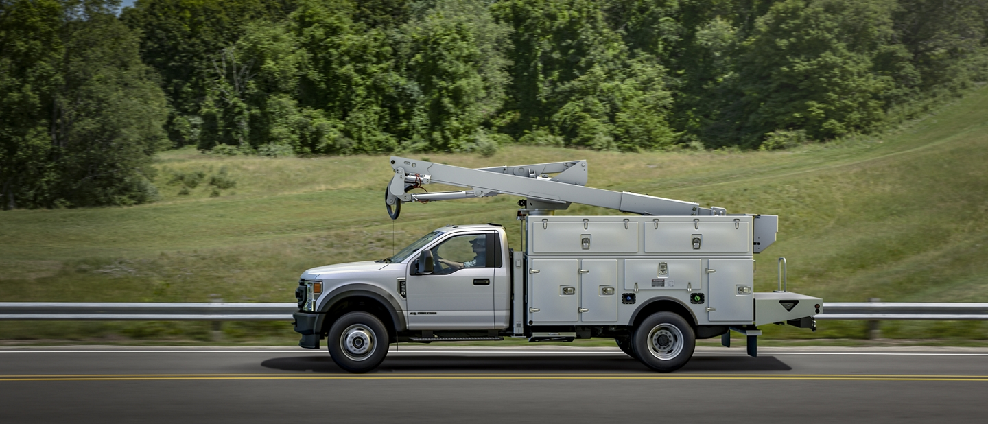 2020 Ford Super Duty Chassis Cab with Upfit driving on road side View