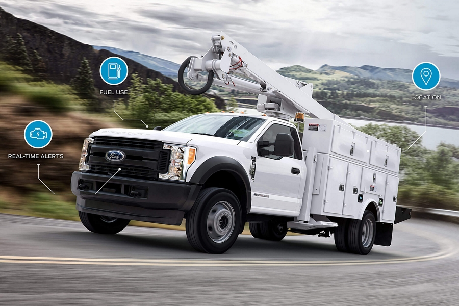 2020 Ford Super Duty Chassis Cab with the generator upfit driving down a road