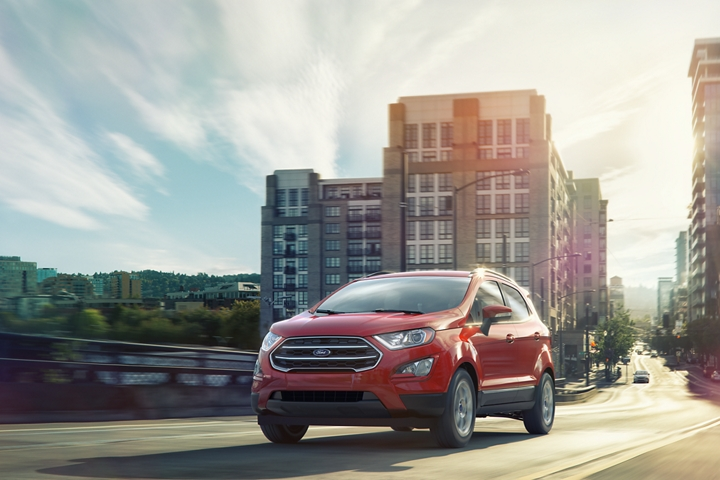 2019 Ford EcoSport S E in Race Red being driven on a city street