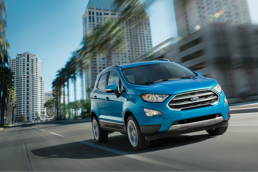 2019 Ford EcoSport Titanium in Blue Candy being driven on a city street