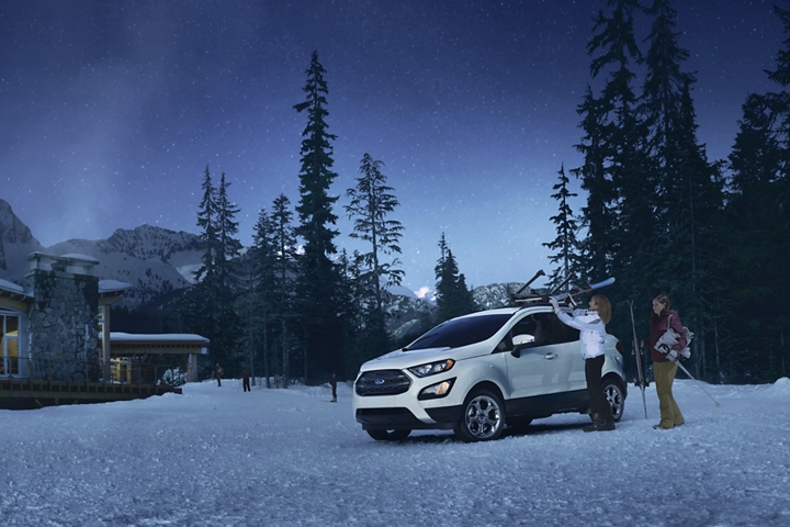 2019 EcoSport S E S on a snowy hill parked in front of a cabin
