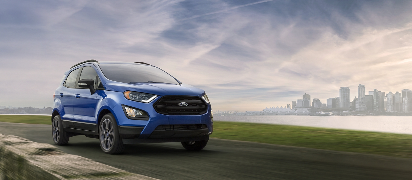 2019 EcoSport in Lightning Blue on a mountain road with cityscape in the background