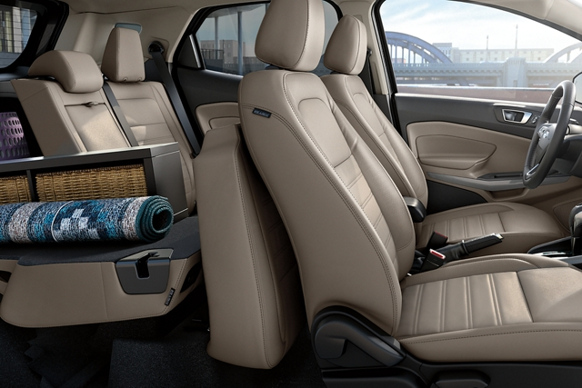 2019 Ford EcoSport Interior with a rug and other household items in the trunk with one of the second row seats folded for extra storage