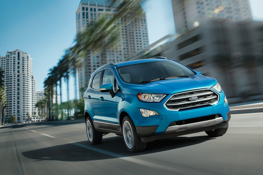 2020 Ford EcoSport Titanium in Blue Candy being driven down a city street