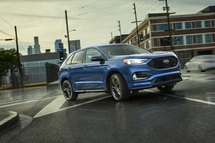 2020 Ford Edge S T shown in Ford Performance Blue being driven after the rain