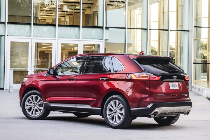 2020 Ford Edge Titanium Shown in Rapid Red in front of glass building
