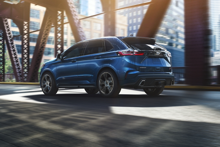 2020 Ford Edge shown in Ford Performance Blue exploring the city