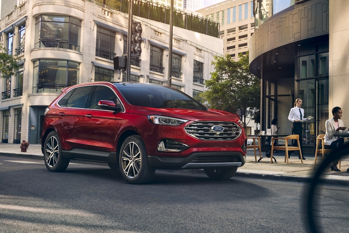 2020 Ford Edge shown in Rapid Red outside of a cafe