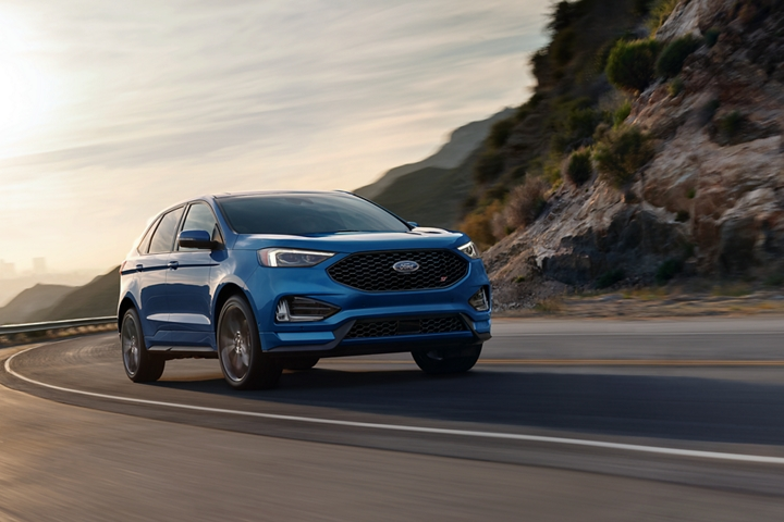 2020 Ford Edge S T shown in Ford Performance Blue escaping the city
