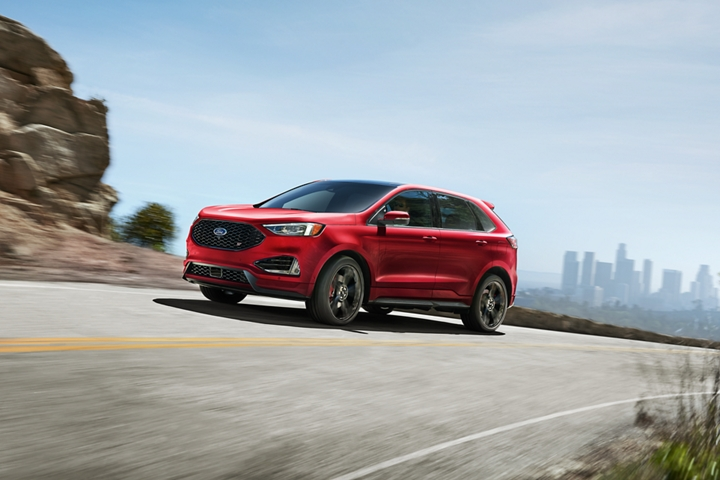 2020 Ford Edge S T shown in Rapid Red with city in background