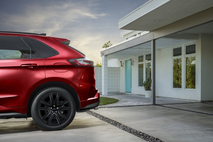 Rear of 2020 Ford Edge S T Line in Rapid Red in driveway at modern home