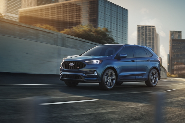2020 Ford Edge S T shown in Ford Performance Blue with city in background