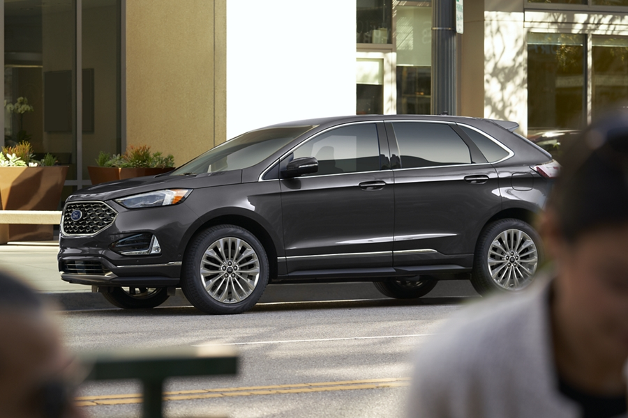 2020 Ford Edge Titanium with Elite Package shown in Magnetic parked on a city street